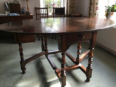 1 Old Charm solid dark oak, oval, drop leaf dining table, 6 rush seat, chairs