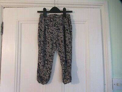 4-5 yr: Grey floral summer trousers: Viscose: NEXT: Good condition: Combine post