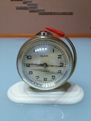 """Vintage USSR. Alarm clock """"SLAVA"""" with a rocket, the beginning of the 60"""