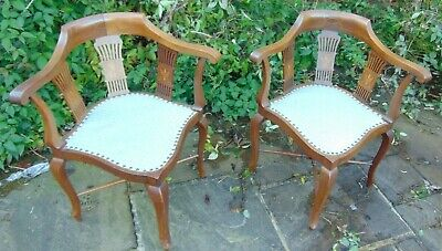 A pair of Edwardian corner chairs