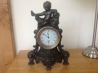 Smiths vintage 8day car clock mounted in a cast iron case