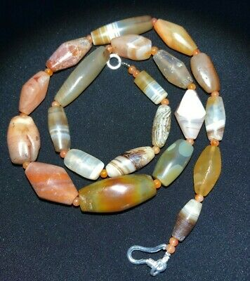 A superb collection of museum quality Bactrian jasper barrel beads temporarily r