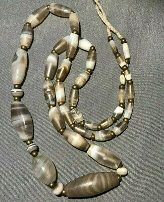 Bactrian banded agates beads, etched carnelian bead. 3rd-2nd millennium BC