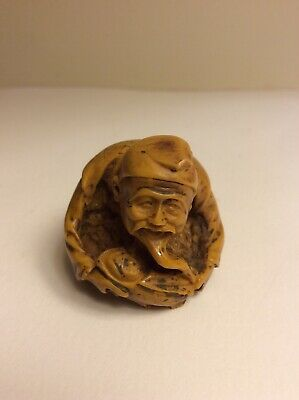 VTG Asian Resin CARVING Sculpture Kneeling Man Over The Baby Yellow Amber Color