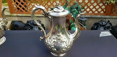 A Victorian Antique Silver Plated bulbous shape Tea Pot With Respoused Patterns.