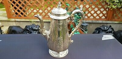 An Antique Victorian Silver Plated Tea Pot With Floral Respoused Patterns.