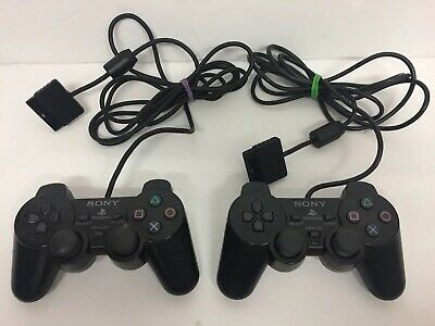 2 x GENUINE SONY SCPH-10010 PLAYSTATION 2 PS2 BLACK DUALSHOCK 2 CONTROLLERS.