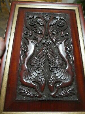 Pair  Antique hand carved red hard wood panels, Griffins, framed Oriel Gallery