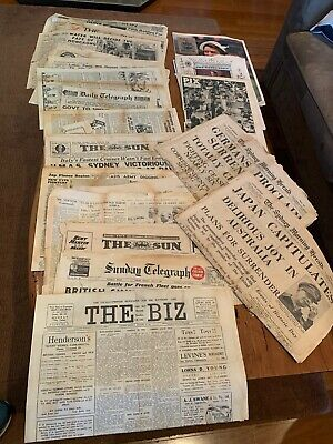 vintage newspapers from the Second World War and 1954