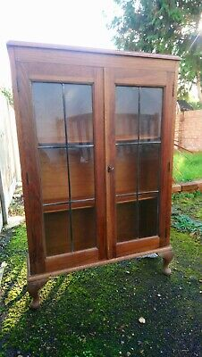 Oak display cabinet/book case with leaded glass doors
