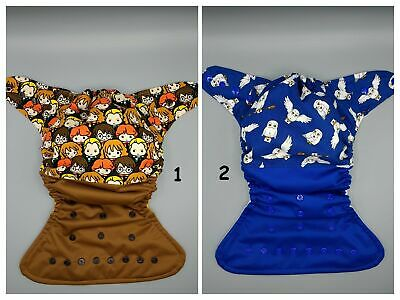 SassyCloth OS pocket cloth diaper with magic school wizards and owl cotton print
