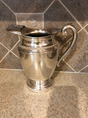 Ornate WATER PITCHER WITH ICE LIP Silver On Copper