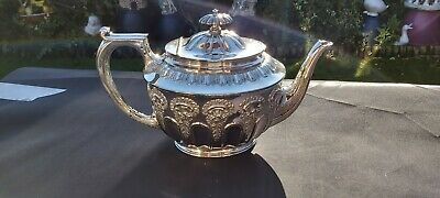 An Antique victorian Silver Plated Tea Pot With Respoused Patterns By W&hs.