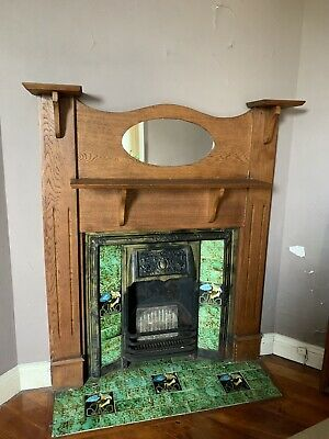 Great condition antique cast iron fireplace, wooden mantelpiece with mirror.