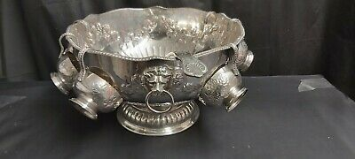 An Antique Silver Plated respoused Punch Bowl.cups.ladle By pinder Brothers.