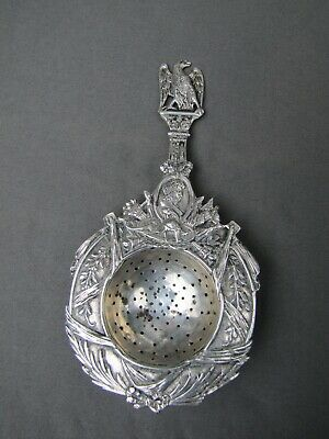 Sterling silver antique military motif tea strainer