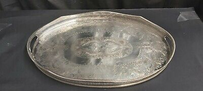 An Antique Silver Plated Wave Effect Gallery Tray With Engraved Patterns.