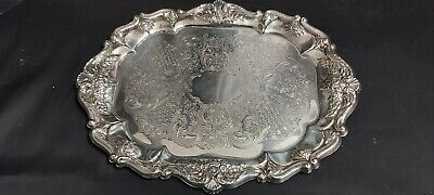 An Antique Silver Plated Serving Tray With Beautiful decorated patterns.