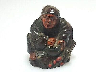 A wonderful Meiji Period Lacquered Figural Netsuke Of A Beggar with Bowl.