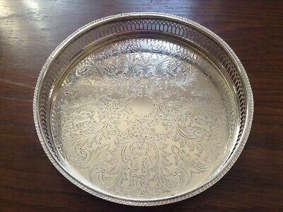 Silver plated round gallery tray with etched design good condition