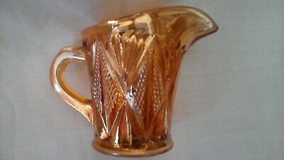 Milk jug/creamer in collectable Carnival glass, marigold colour