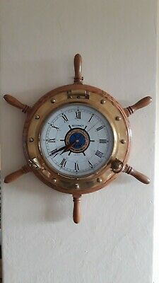 Wall clock ships wheel with solid brass porthole inlaid into wheel