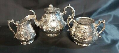 A Victorian Antique Silver Plated Tea Set With Embossed Patterns And Acorn...