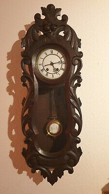 Very rare Lenzkirch wall clock with hand carved door