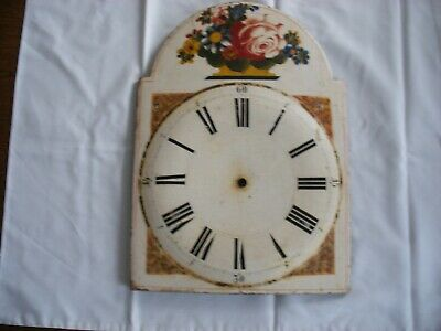 An Antique Painted Wooden Clock Face and Another