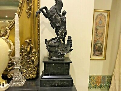 An Original Antique pair of Bronze Mantle Statues very heavy on a Mable Base