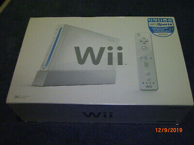 Nintendo White Console, plus remotes, Wii Sports, and accessories