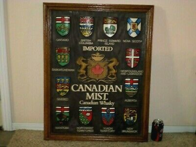 "CREST EMBLEMS OF IMPORTED CANADIAN MIST WHISKY, FRAMED WOODEN WALL ART, 24""x31"""