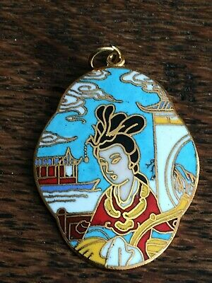 Gold tone and enamel decorated oval pendant of an oriental lady