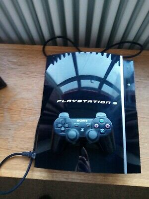 playstation 3 with controller and FIFA 18 game