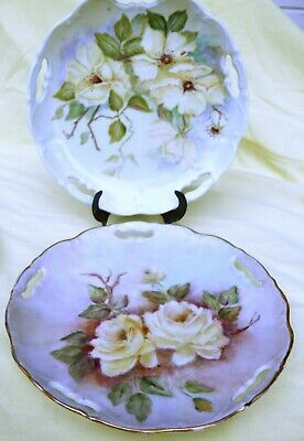 Two hand painted Floral Plates Signed