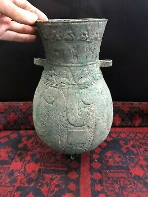 An old Pot  with green patina on its surface probably used as a vase to place fl