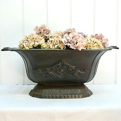 Large antique 2 foot long cast iron jardiniere or planter with classical design