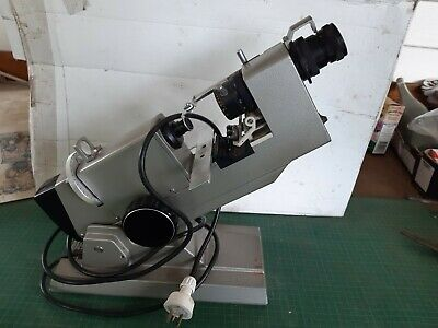 Vintage optometrist's tool, machine, has lens and magnifying. TOPCON LM-T5 JAPAN