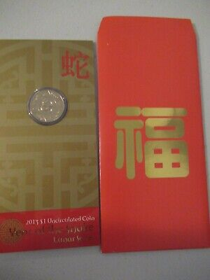 2013 $1 unc coin on card Year of the Snake, RAM Lunar Series