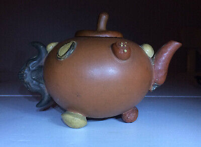 """Chinese Yixing stoneware 'hundred-fruit' teapot and cover.19thC.Marked  """"An Ji"""""""