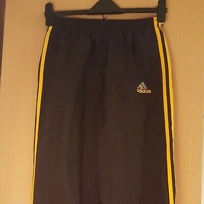 Vintage waterproof Adidas tracksuit bottoms (girls/womens)