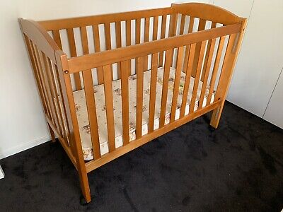 Timber Cot in good condition