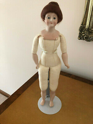 Porcelain/Bisque Doll - White 42 cm tall, on a stand