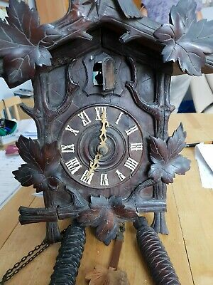 Large very old cuckoo clock - wooden frame holding mechanism.