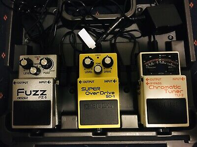 Guitar pedal board w/ pedals. Boss TU-2 Tuner, SD-1 and FZ-5 Fuzz.
