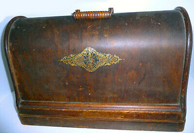 Antique Singer 48k wooden base and bentwood cover.