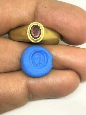 A roman period Intaglio Gold ring with an ancient Agate bead with engravings of