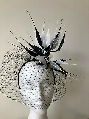 New black and white feathered fascinator with netting on a headband!
