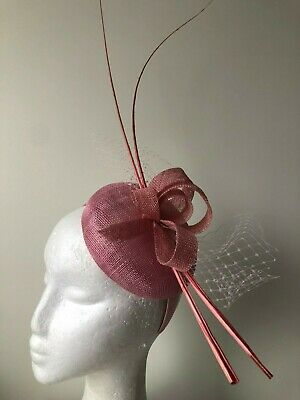 Pink round fascinator with loops, netting and barb quills!
