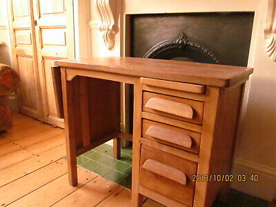 Desk, chlid's antique oak, with three drawers, foldable side and pull out board.
